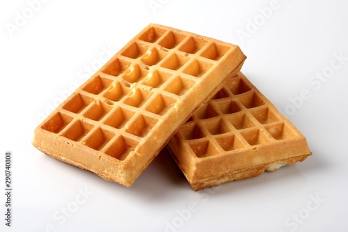 Photo sur Aluminium Boulangerie Belgian waffles. Baked waffles on a white background.
