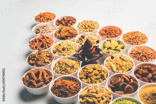 Foto op Canvas Kruiden 2 Rangoli of Farsan/snacks in bowls for Diwali with diya