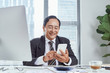 business, communication and technology concept - businessman using smartphone at office
