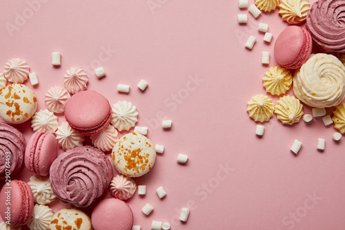 Aluminium Prints Macarons Smashed delicious sweet meringues, macaroons and small marshmallows pieces on pink background