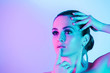 canvas print picture Portrait of model posing in studio with color neon lights