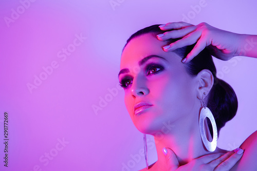 canvas print motiv - oksix : Woman with bright makeup in color lights
