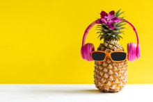 Summer In The Party.  Hipster Pineapple Fashion In Sunglass And Music Bright Beautiful Color In Holiday, Creative Art Fruit For Tropical Style On The Beach Vibes, Yellow Background.