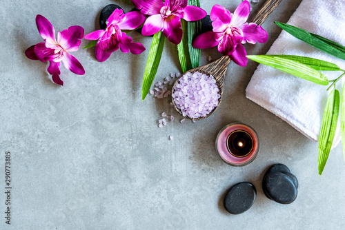 Foto op Plexiglas Spa Thai Spa. Top view of hot stones setting for massage treatment and relax with purple orchid on blackboard with copy space. Lifestyle Healthy Concept
