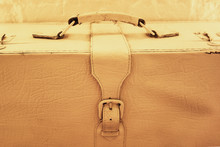 Old Style Vintage Rustic Suitcase. White Painted Leather Bag Or Trunk With Metal Buckle Strap And Handle Close Up Image. Concept Of Travel Or Fashion