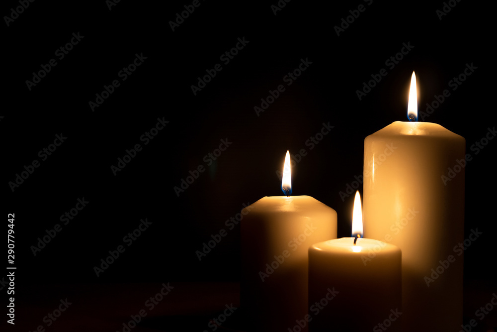 Fototapeta Christmas advent candle light in church with blurry golden bokeh for religious ritual, spiritual zen meditation, peaceful mind and soul or funeral worship ceremony - obraz na płótnie