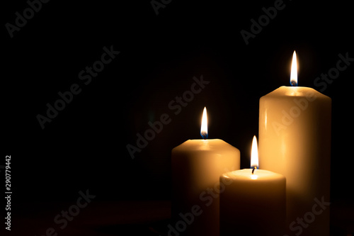 Christmas advent candle light in church with blurry golden bokeh for religious r Wallpaper Mural