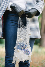 Girl In A Coat With A String Bag Decorated With Baroque Pearls