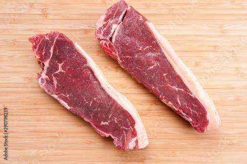 Recess Fitting Steakhouse raw new york strip steak