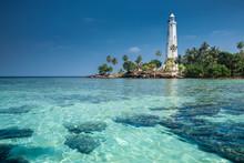 Lighthouse And Beautiful Beach...