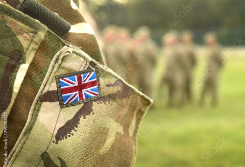 Obraz UK flag on soldiers arm. UK military uniform. United Kingdom troops - fototapety do salonu
