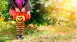 canvas print picture - Little Girl With Candy basket On Meadow - Halloween Trick Or Treat Concept