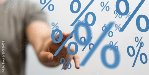 Photo  hand touches virtual percent icon