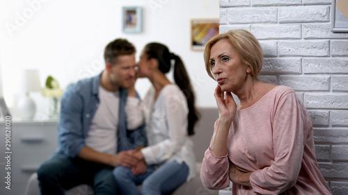 Fototapety, obrazy: Curious mother-in-law secretly listening woman whispering secret on husband ear