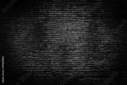 Photo Stands Retro Black brick walls that are not plastered background and texture. The texture of the brick is black. Background of empty brick basement wall.