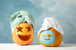 Leinwandbild Motiv Funny pumpkins with towels on white background, space for text