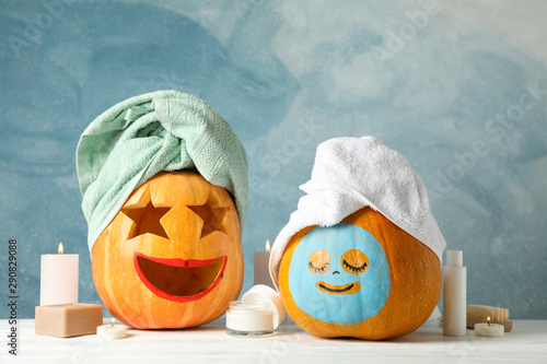 Acrylic Prints Spa Funny pumpkins and skin care accessories on white background, copy space