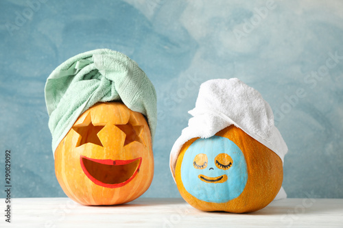 Foto auf Leinwand Spa Funny pumpkins with towels on white background, space for text
