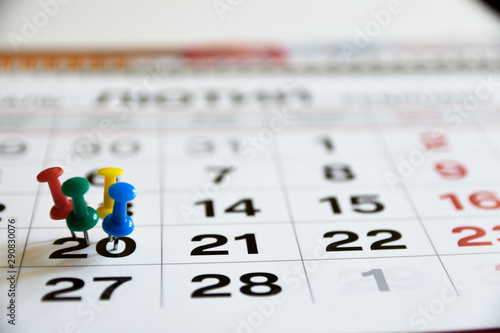Fényképezés  Thumbtack in calendar concept for important date or busy day, appointment and meeting reminder