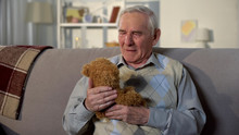 Depressed Old Male Holding Ted...