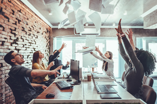 fototapeta na szkło Teamwork business people excited happy smile, throw papers and documents fly in air.