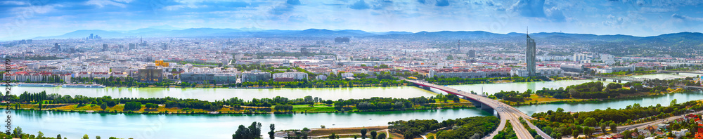 Fototapety, obrazy: Stunning aerial panoramic cityscape view austrian capital city of Vienna.  Modern glass-concrete skyscrapers in the ancient city on the banks the Danube -of the largest river in Europe. Hot summer day