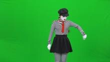 Mime Girl Is Driving A Car. Green Screen, Chroma Key.