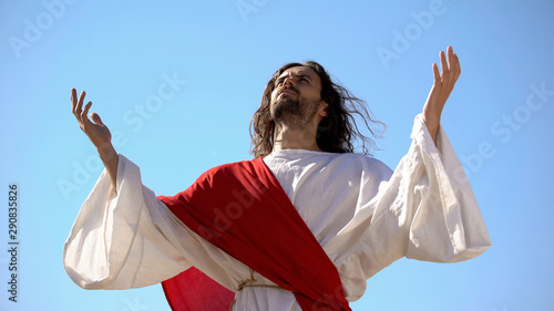Photo Jesus raising hands to sky and praying, resurrection and ascension of Christ