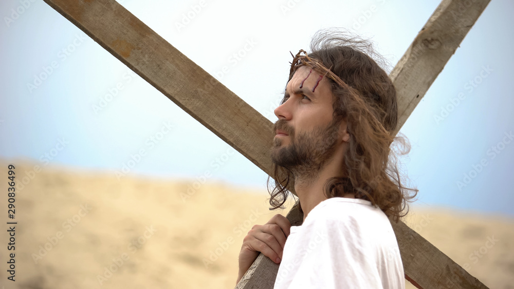 Fototapety, obrazy: Jesus Christ with crown of thorns carrying cross, praying to God for sinners