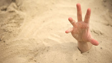 Hand Sinking In Quicksand, Try...