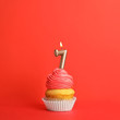 canvas print picture - Birthday cupcake with number seven candle on red background