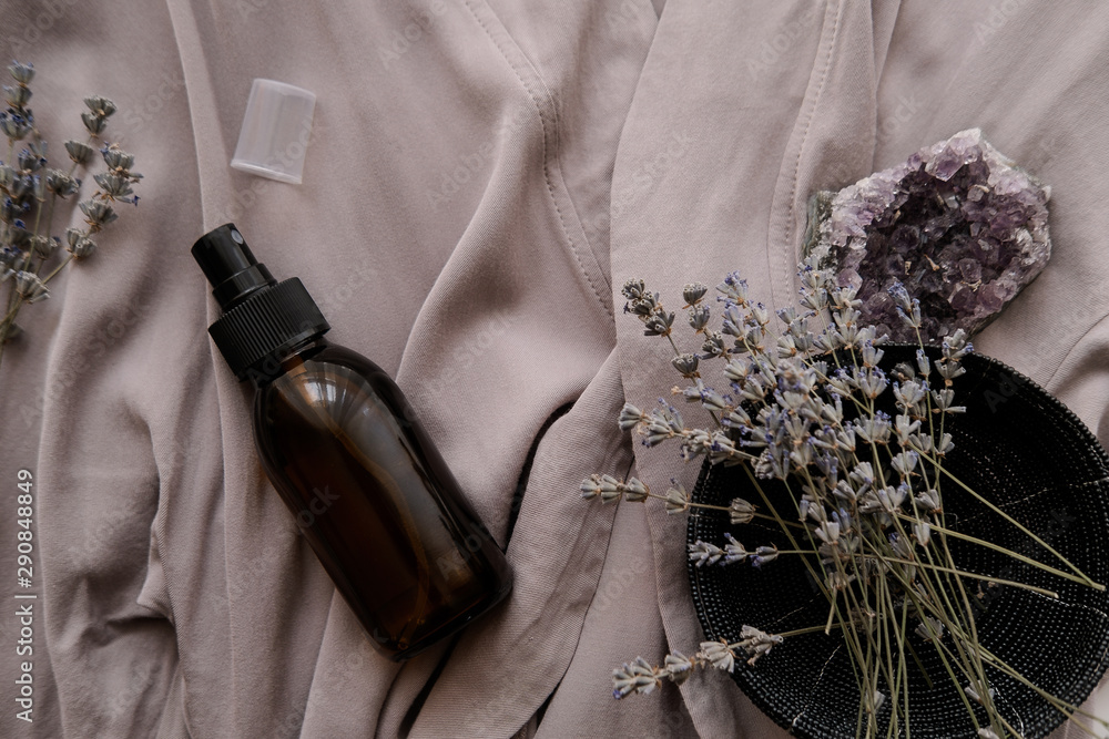 Fototapety, obrazy: Glass brown spray bottle with organic cosmetics on gray fabric. Beauty blogging concept