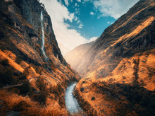 Beautiful Mountains Covered Orange Grass In Autumn. Colorful Landscape With Mountain Valley, River, Waterfall, Meadows And Forest, Sky With Clouds In Fall At Sunset. Travel In Himalayas. Nature