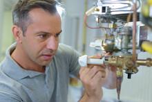 A Technician Repairing Electri...