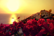 Picturesque Castle Of Astypalaia Island As Seen At Sunrise Through Beautiful Bougainvillea In Blossom, Dodecanese, Greece