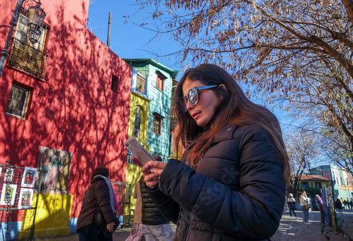 Photo Stands Buenos Aires Female tourist in La Boca, Buenos Aires, Argentina