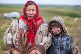 The extreme north, Yamal, the past of Nenets people, the dwelling of the peoples of the north, a family photo near the yurt in the tundra