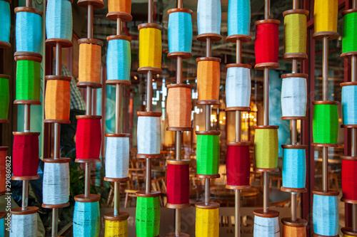Photo multicolored thread bobbin background, Sewing threads as a multicolored backgrou