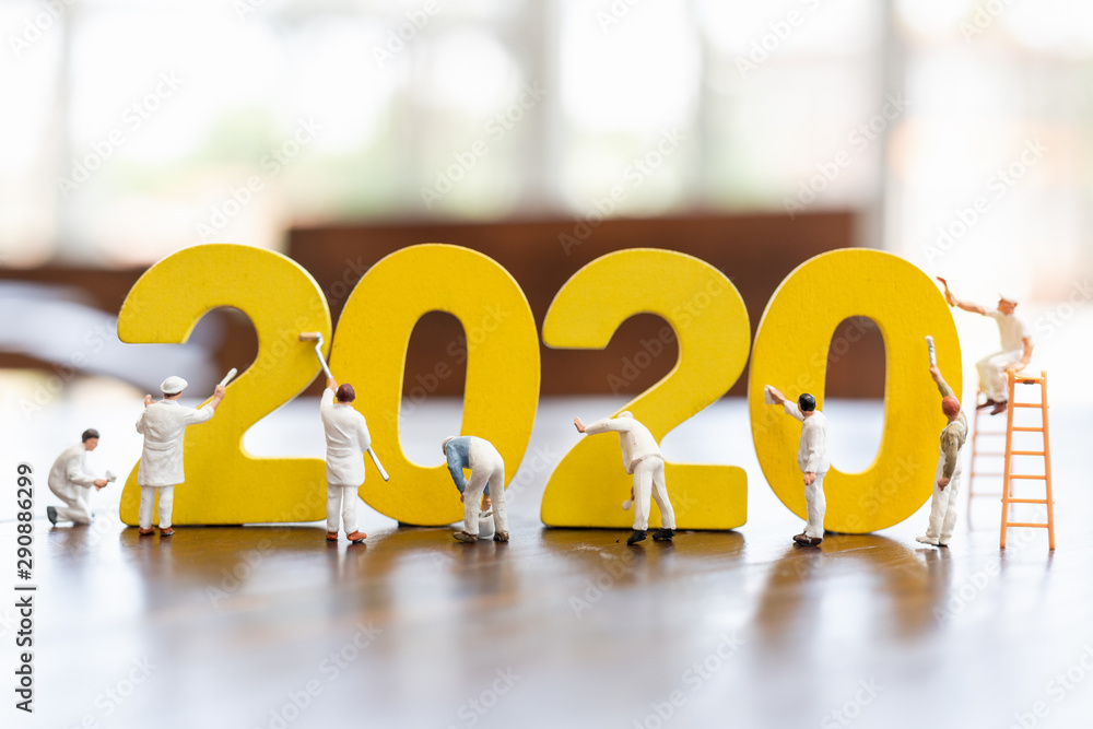 Fototapeta Miniature worker team painted number 2020  , Happy new year 2019 concept