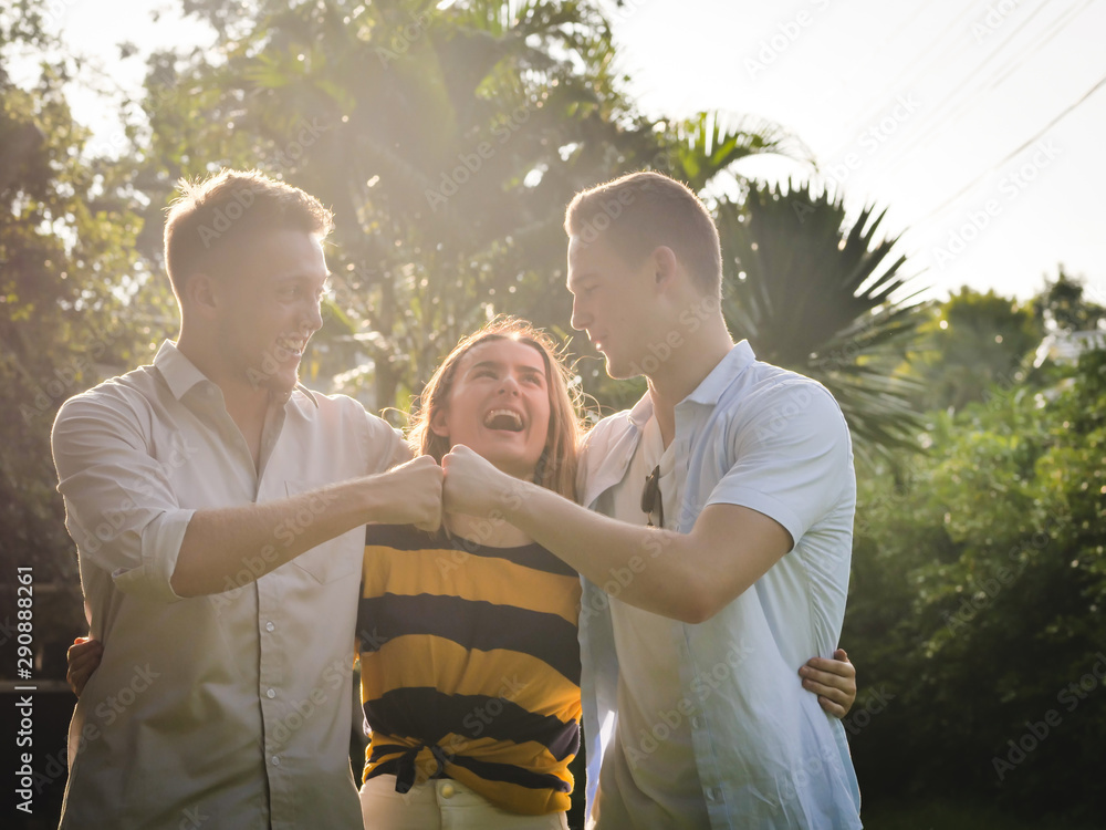 Fototapety, obrazy: Laughing university students using tablet together hugging together in relationship, lifestyle concept.