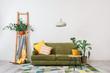 Leinwanddruck Bild Stylish interior of living room with sofa and plants