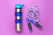 canvas print picture - Sports water bottle and jumping rope on color background