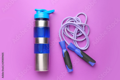 canvas print motiv - Pixel-Shot : Sports water bottle and jumping rope on color background