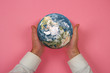 canvas print picture - the earth in the hand, pink packground