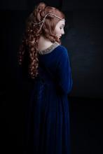 Medieval Woman In Blue Velvet Dress