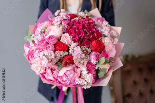 Ecole de Danse Pink peonies and red hydrangea. Beautiful bouquet of mixed flowers in woman hand. Floral shop concept . Handsome fresh bouquet. Flowers delivery. Red and pink color.