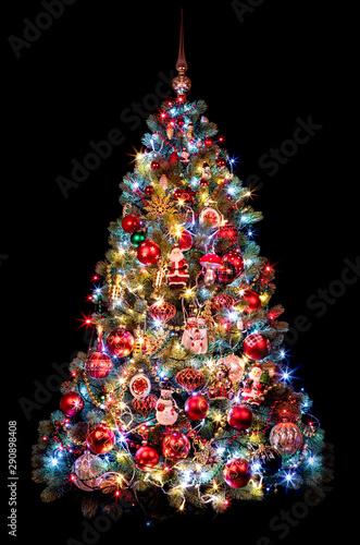 Obraz Beautiful Christmas tree on a black background. new year concept - fototapety do salonu