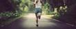 Leinwanddruck Bild - Female runner running at summer park trail . Healthy fitness woman jogging outdoors.