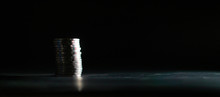 Thai Ten Baht Coins Stacked On A Black Background