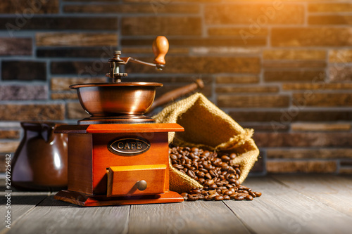 still life with coffee beans and old coffee mill on the wooden background,coffee Wallpaper Mural